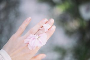 Self-Care Habits - Flowers on a woman's hand