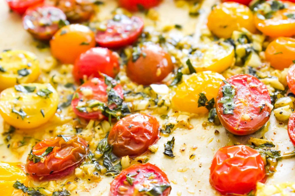 Garlic roasted cherry tomatoes on parchment paper