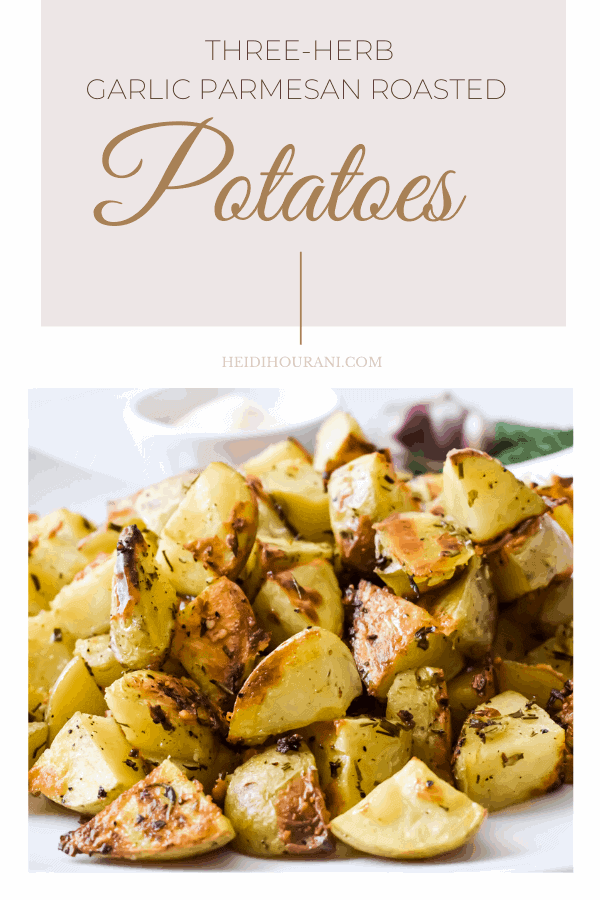 Three Herb Garlic Parmesan Roasted Potatoes are crispy on the outside and fluffy and tender on the inside. Loaded with fragrant herbs, garlic, parmesan cheese and lemon zest make this the Best herb garlic parmesan roasted potatoes ever! #roastedpotatoes #potatorecipe #sidedish #parmesanpotatoes #easysidedishrecipes