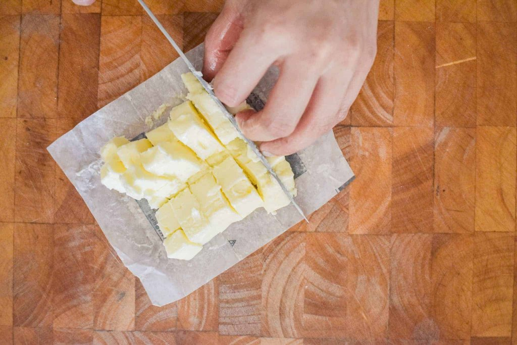 Slicing butter into small chunks