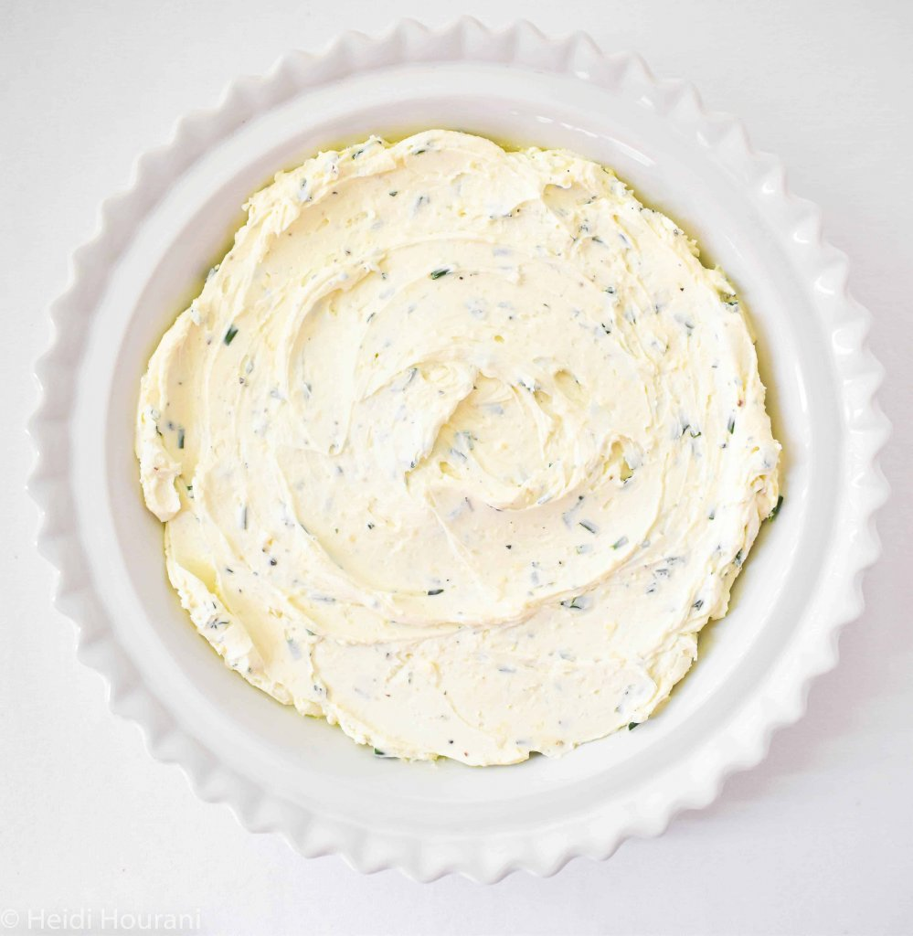 a white baking dish with goat cheese dip prior to baking