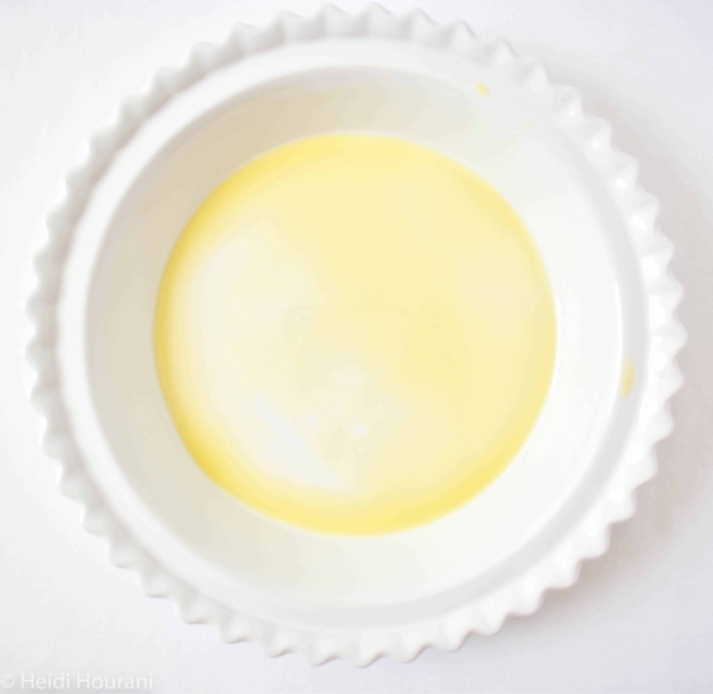 a white baking dish with olive oil